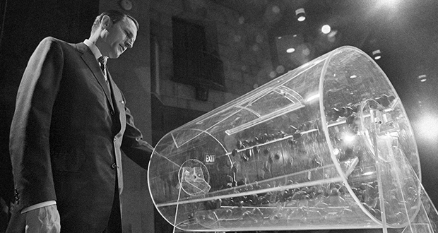 Draft director Curtis W. Tarr spins one of the two Plexiglas drums on Feb. 2, 1972, in Washington as the fourth annual Selective Service lottery begins. (AP file photo)