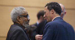 Theatrice Williams, the state's original corrections ombudsman, chats with Sen. Ron Latz, DFL-St. Louis Park, after a March 6 committee hearing. Latz is carrying a bill to revive the ombudsman, which has been defunct since its budget was eliminated in 2003. (Staff photo: Kevin Featherly)