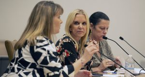 Sen. Karin Housley, R-St. Marys Point, center, listens to attorney Leslie Lienemann, left, testify during a March 15 Senate Judiciary committee hearing. Attorney Sheila Engelmeier, right, also is pictured. (Staff photo: Kevin Featherly)