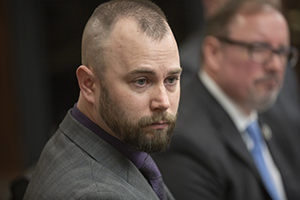 Marko Milosovic listens to a lawmaker during a March 7 House Judiciary committee hearing. The 12-tour combat veteran testified for House File 988. (Staff photo: Kevin Featherly)