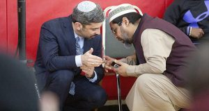 Rabbi Adam Stock Spilker, left, confers with Imam Asad Zaman during a Muslim solidarity event at the Dar Al-Farooq Islamic Center in Bloomington on Saturday. (Staff photo: Kevin Featherly)