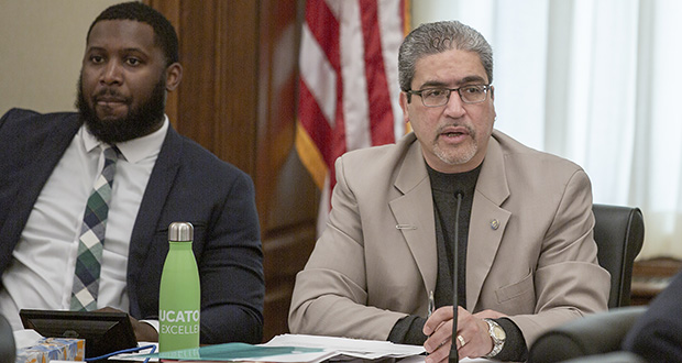 Rep. Carlos Mariani, DFL-St. Paul, the House Public Safety and Criminal Justice Reform Committee chair, convenes the April 2 hearing where his 223-page omnibus finance bill was first heard. Committee Administrator Jamael Lundy is pictured to Mariani's right. (Staff photo: Kevin Featherly)