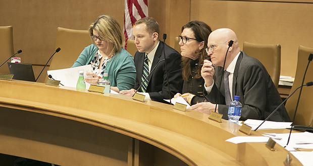 Flanked by committee staff, Sen. Julie Rosen, R-Vernon Center (third from left) presides over the Senate Finance Committee. (Staff photo: Kevin Featherly)