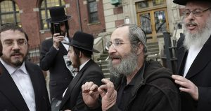 A man who would not identify himself talks to the media April 9 about the measles outbreak in the Williamsburg section of Brooklyn in New York. He said that he has had his children vaccinated but that he respects the right of other parents to decide not to have their children vaccinated. (AP photo)