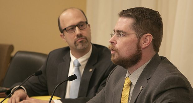 Rob Doar, (right) political director for the Minnesota Guns Owners Caucus testifies at the Capitol Tuesday as Rep. Dave Pinto, DFL-St. Paul, looks on. Doar said any further attempts by DFLers to push gun laws this year would resemble the Greek king Sisyphus' impossible quest to roll a bolder up a slope. (Staff photo: Kevin Featherly)