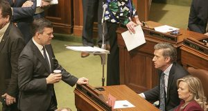 House Majority Leader Ryan Winkler, DFL-Golden Valley (left), chats with House Minority Leader Kurt Daudt, R-Crown (seated) on the House floor Friday. The special session ended after 21 hours without Daud executing on a threat not to support suspending House rules. That move would have made the session last at least three days. (Staff photo: Kevin Featherly)