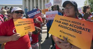 Immigration activists rally outside the Supreme Court in Washington on April 23 as the justices hear arguments over the Trump administration's plan to ask about citizenship on the 2020 census. (AP file photo)