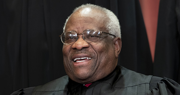 In this Nov. 30, 2018, file photo, Supreme Court Associate Justice Clarence Thomas, appointed by President George H. W. Bush, sits with fellow Supreme Court justices for a group portrait at the Supreme Court Building in Washington. (Associated Press Photo/J. Scott Applewhite)