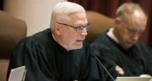 Minnesota Supreme Court Justice David Lillehaug asks questions during oral arguments at the Capitol in St. Paul on Aug. 28, 2017. Lillehaug says he has Parkinson's disease and won't seek re-election next year. (AP photo: Star Tribune)