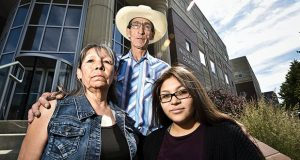 Cletus Cole, mother, Earline Bearcrane Cole, father, and Precious Bearcrane, daughter, to Steven Bearcrane Cole, who was shot to death in 2005, stand on the steps of the Paul G. Hatfield Federal Courthouse Tuesday, July 2, 2019 after a hearing in the 10-year-old civil lawsuit questioning the FBI investigation into Bearcrane's death.  (Thom Bridge/Independent Record via AP)