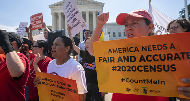 Demonstrators gather June 27 at the Supreme Court. The Justice Department said Tuesday that the 2020 Census is moving ahead without a question about citizenship. (AP file photo)