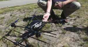 In this June 9, 2017, photo, Gary Reynolds, police drone instructor from Virginia, points out some of the features of a drone in Rochester, Minnesota. Rochester police acquired the drone to help find adults and children who wander due to Alzheimer's, autism and other disorders. (AP file photo: The Rochester Post-Bulletin)