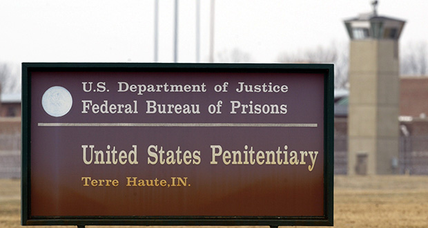 A guard tower flanks the sign at the entrance to the U.S. Penitentiary in Terre Haute, Indiana, the site of the last federal execution.  (AP file photo)