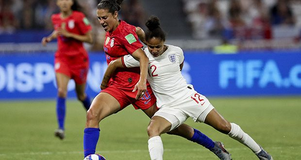 England's Demi Stokes, right, and United States' Carli Lloyd duel for the ball during the Women's World Cup semifinal soccer match July 2 between England and the United States, at the Stade de Lyon outside Lyon, France. (AP photo)