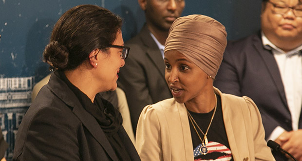 U.S. Rep. Ilhan Omar, DFL-Minnesota (right), speaks to U.S. Rep. Rashida Tlaib, D-Mich., on Aug. 19, during a rare local press conference for the Minnesota congresswoman. Omar spoke exclusively about Israel and took just three questions. (Staff photo: Kevin Featherly)