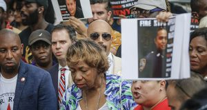 Gwen Carr, center, the mother of chokehold victim Eric Garner, attends a news conference after New York Police Commissioner James O'Neill announced his decision to fire officer Daniel Pantaleo on Monday. (AP photo)