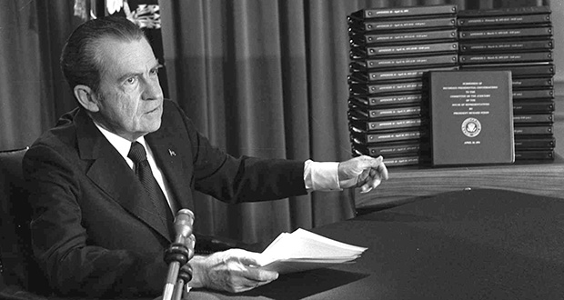 In this April 29, 1974, file photo, President Richard M. Nixon points to the transcripts of White House tapes after announcing he would turn them over to House impeachment investigators. That did not satisfy investigators, and the Supreme Court ordered the release of the audio recordings. (AP file photo)