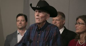 """Chanhassen rancher and Republican activist Bonn Clayton, foreground, is a plaintiff in a lawsuit that challenges Minnesota Statutes Section 211B.02 as an unconstitutional """"content-based restriction on political speech."""" (Staff photo: Kevin Featherly)"""