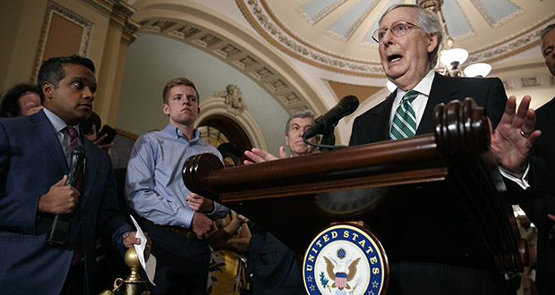 Senate Majority Leader Mitch McConnell of Kentucky, right, speaks to the media July 30 with Senate Republican leaders. (AP photo)