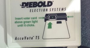 This May 2018 photo shows a voter access card inserted in a reader during voting in the Georgia primary in Kennesaw, Georgia. A federal judge has ordered Georgia to stop using its outdated voting machines after 2019. (AP file photo)