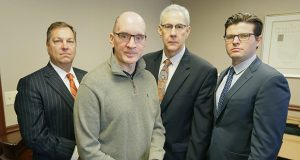 Mark Kedrowski, front, was severely injured in a plane crash in 2010. He and his legal team, from left, Cortney LeNeave, Stephen Watters and Thomas Fuller, procured a $27.7 million verdict from a Ramsey County jury. (File photo: Bill Klotz)