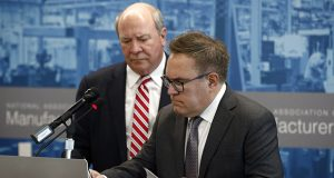 Environmental Protection Agency Administrator Andrew Wheeler, right, signs a document in front of Assistant Secretary of the Army for Civil Works R.D. James to revoke the Waters of the United States rule, an Obama-era regulation that provided federal protection to many U.S. wetlands and streams, on Sept. 12 in Washington. (AP photo)