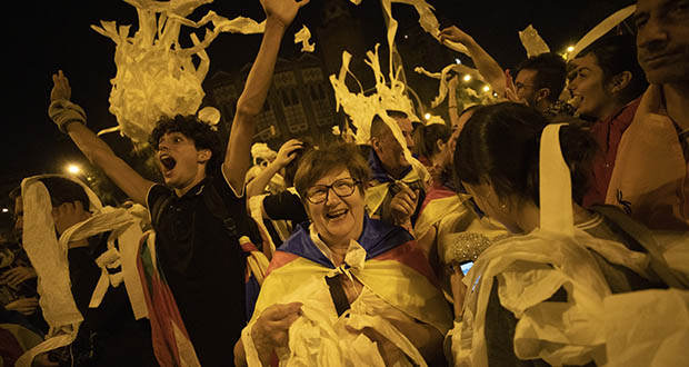 Catalan pro-independence demonstrators throw paper toilet rolls into the air during a protest in Barcelona Spain, Wednesday, Oct. 16, 2019.  (AP Photo/Bernat Armangue)