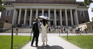 In this July 16 photo, people stop to record images of Widener Library on the campus of Harvard University in Cambridge, Massachusetts. (AP file photo)