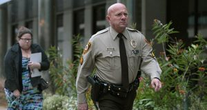 In this Oct. 24th photo, St. Louis County police Sgt. Keith Wildhaber returns from lunch break to the St. Louis County courthouse on Oct. 24, the third day of his discrimination case against the county in Clayton, Missouri. (AP file photo: St. Louis Post-Dispatch)