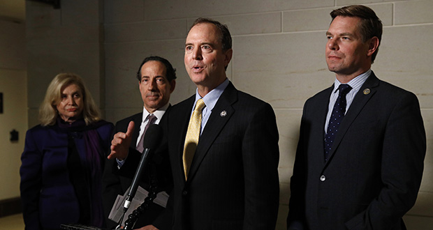 Rep. Adam Schiff, D-Calif., center, speaks with members of the media Monday after former deputy national security adviser Charles Kupperman signaled that he would not appear as scheduled to testify as part of the House impeachment inquiry into President Donald Trump. Standing with Schiff are, from left, Carolyn Maloney, D-N.Y., Rep. Jamie Raskin, D-Md., and Rep. Eric Swalwell, D-Calif. (AP photo)