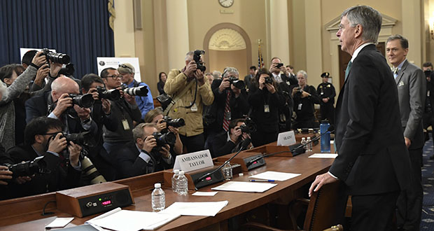 Top U.S. diplomat in Ukraine William Taylor, second from right, and career Foreign Service officer George Kent, right, return to testify Wednesday following a recess of the House Intelligence Committee' impeachment hearing on Capitol Hill in Washington. (AP photo)