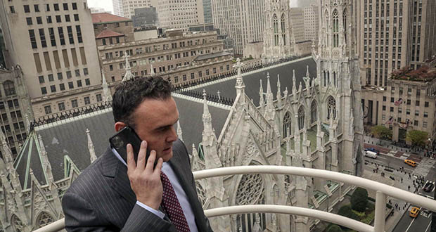 Attorney Adam Slater takes a phone call Oct. 29 on a patio outside his high-rise Manhattan office overlooking St. Patrick's Cathedral, in New York. (AP photo: Bebeto Matthews)