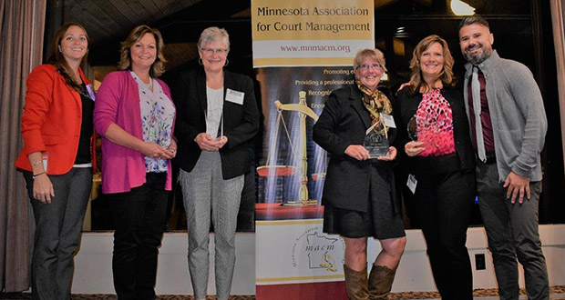 Left to Right: Mary Dalbec , Minnesota Association for Court Management vice president, Monica Tschumper of Wright County District Court, Angie Hutchins of the 3rd Judicial District, Sharon Schubert of Kanabec County District Court, Gena Jones of Washington County District Court, Aaron Williamson, MACM president.