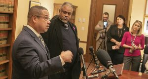 Minnesota Attorney General Keith Ellison, left, stands with Public Safety Commissioner John Harrington during a Dec. 5 press conference. The officials updated the media on the progress of their Working Group on Police-Involved Deadly Force Encounters, which they co-chair. (Staff photo: Kevin Featherly)