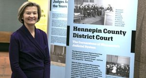 Hennepin County District Court Chief Judge Ivy Bernhardson stands near a display in the court history museum that she has been trying to get off the ground for three years. The judge is a major history buff. (Staff photo: Kevin Featherly)