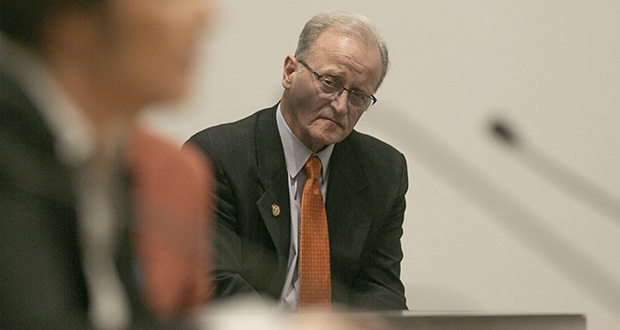 From the audience, Sen. Warren Limmer takes in testimony from Jennifer Schroeder, currently serving a 40-year probation on a Wright County felony drug conviction, during a Sentencing Guidelines Commission hearing Dec. 19. (Staff photo: Kevin Featherly)