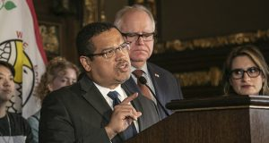 Attorney General Keith Ellison speaks to reporters after announcing a lawsuit his office filed Wednesday against San Francisco e-cigarette company Juul Labs Inc. The state's 82-page complaint accuses Juul of breaking state consumer-protection laws, breaching its duty of reasonable care and creating a public nuisance. Gov. Tim Walz and Lt. Gov. Peggy Flanagan also are pictured. (Staff photo: Kevin Featherly)