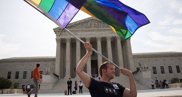 In a June 25, 2015 file photo, John Becker, 30, of Silver Spring, Maryland, waves a rainbow flag in support of gay marriage outside of the Supreme Court in Washington. (AP file photo)