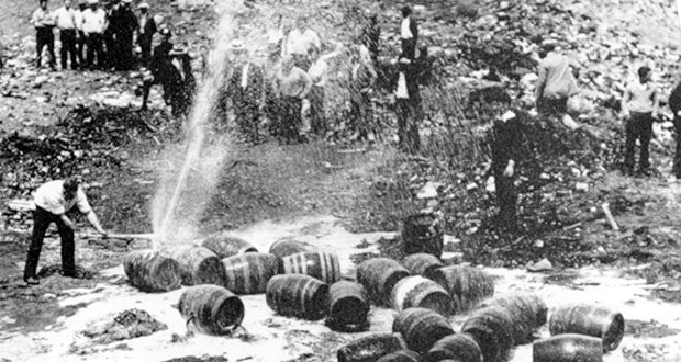 Beer barrels are destroyed by prohibition agents at a dump in New York City in this June 18, 1931, photo. (AP file photo)