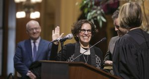 Former Minneapolis City Attorney Susan Segal takes the oath of office from her predecessor, retired Court of Appeals Judge Jill Faskamp Halbrooks, during investiture ceremonies Jan. 16. Segal's husband, MMB Commissioner Myron Frans, watches in the background. Segal is the court's 59th judge. (Staff photo: Kevin Featherly)