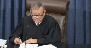 In this image from video, Supreme Court Chief Justice John Roberts speaks Tuesday during the impeachment trial of President Donald Trump in the Senate Chamber of the U.S. Capitol in Washington. (Senate Television via AP)