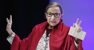 In this Oct. 3, 2019, photo, U.S. Supreme Court Justice Ruth Bader Ginsburg gestures to students before she speaks at Amherst College in Amherst, Massachusetts. (AP file photo: Jessica Hill)