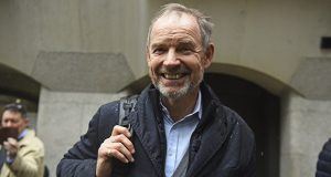 Richard Boath smiles outside the Old Bailey, London, Friday Feb. 28, 2020. (Kirsty O'Connor/PA via AP)