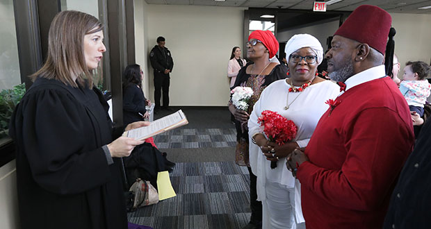 Judge Angela Willms presides over the wedding ceremony of David and Sarratour Walker. The Maple Grove residents have known each other for 40 years. (Photo: Bill Klotz)