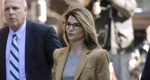 """Lawyers for Lori Loughlin and her husband, the fashion designer Mossimo Giannulli, argued in court filings that notes the corrupt admissions consultant William """"Rick"""" Singer took on his phone while cooperating with the government support their claim that they thought their donations were legitimate. In this April 3, 2019, photo, Loughlin arrives at federal court in Boston to face charges in a nationwide college admissions bribery scandal. (AP file photo)"""