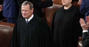 Chief Justice of the United States John Roberts and Supreme Court Associate Justice Elena Kagan arrived before President Donald Trump delivered his State of the Union address to a joint session of Congress on Tuesday in Washington. (AP photo)