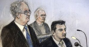 Court artist sketch by Elizabeth Cook, depicting Julian Assange, center, in the dock with his defense team, Edward Fitzgerald, left, and Mark Summers, at Belmarsh Magistrates' Court in London, during an extradition hearing, Monday Feb. 24, 2020. The U.S. government began outlining its extradition case against Wikileaks founder Julian Assange in a London court. (Illustration: Elizabeth Cook/PA via AP)