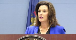 In this Aug. 28, 2019 file photo, Michigan Gov. Gretchen Whitmer speaks at a news conference in Lansing, Mich. Whitmer has signed changes to Michigan's reporting requirements for people who will have to meet work-related requirements to qualify for Medicaid coverage. (AP Photo/David Eggert File)