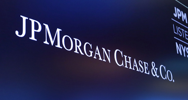 In this Aug. 16, 2019 file photo, the logo for JPMorgan Chase & Co. appears above a trading post on the floor of the New York Stock Exchange. (AP Photo/Richard Drew, File)