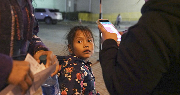 A 7-year-old asylum-seeker waits as her mother, Isabel, right, and immigration lawyer Charlene D'Cruz, left, as they figure out where they will be spending the night after being processed at the Port of Entry in Brownsville, Texas, on Dec. 17, 2019. The girl, who was unable to contain her own waste due to a congenital illness, had been refused entry to the United States three times previously. (AP photo: Veronica G. Cardenas)